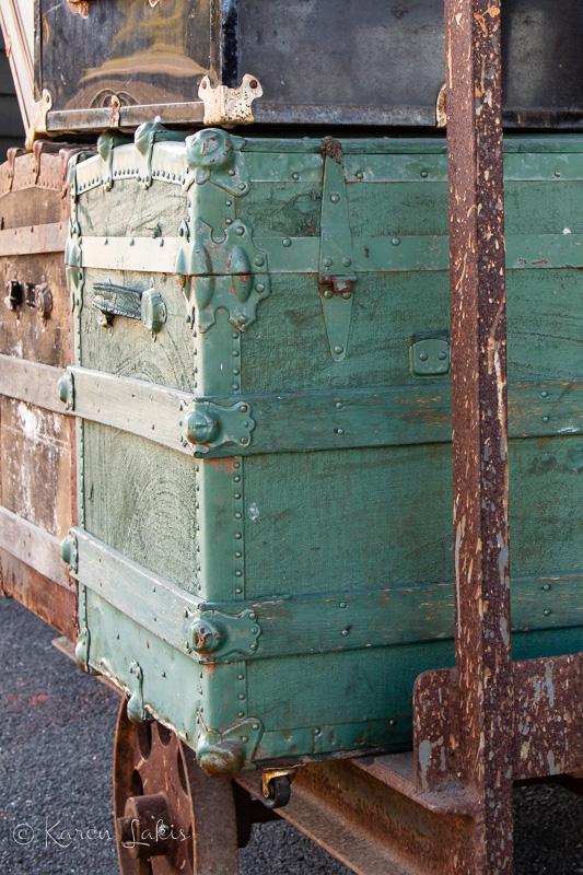 trunks on rusty luggage rack