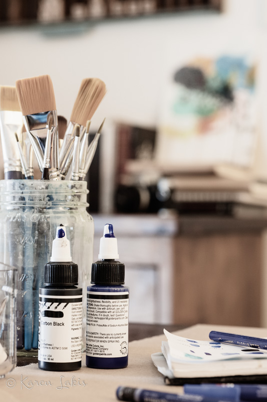 art supplies with dresser blurred in background