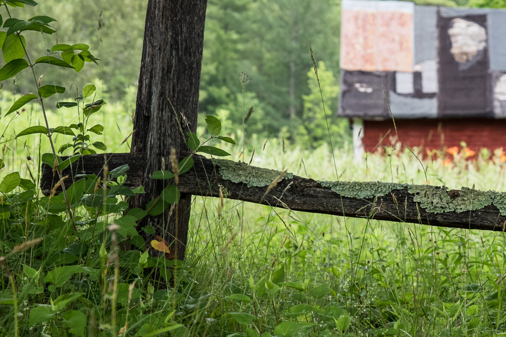 rustic fence with patchwork barn