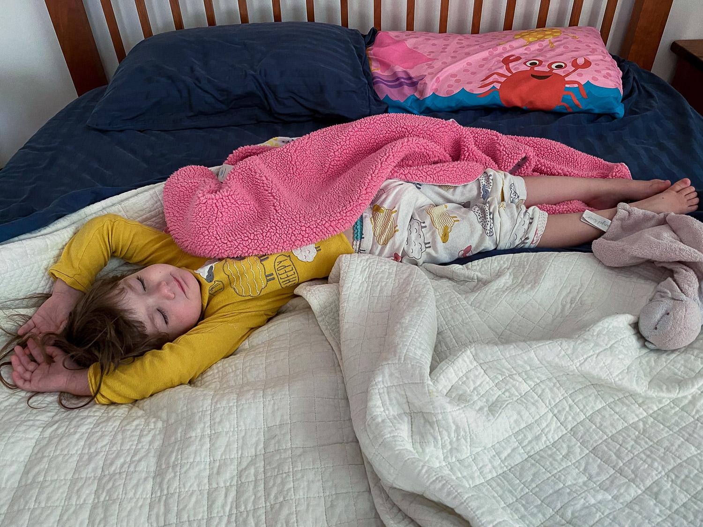 Ella sprawled on the bed