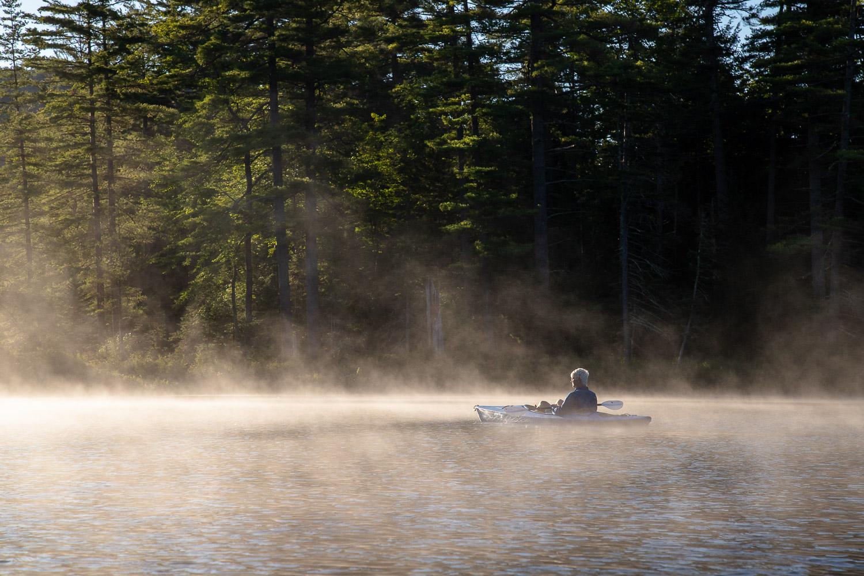 kayaking on a foggy lake